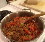 Seitan Cooking with Onions and Peppers