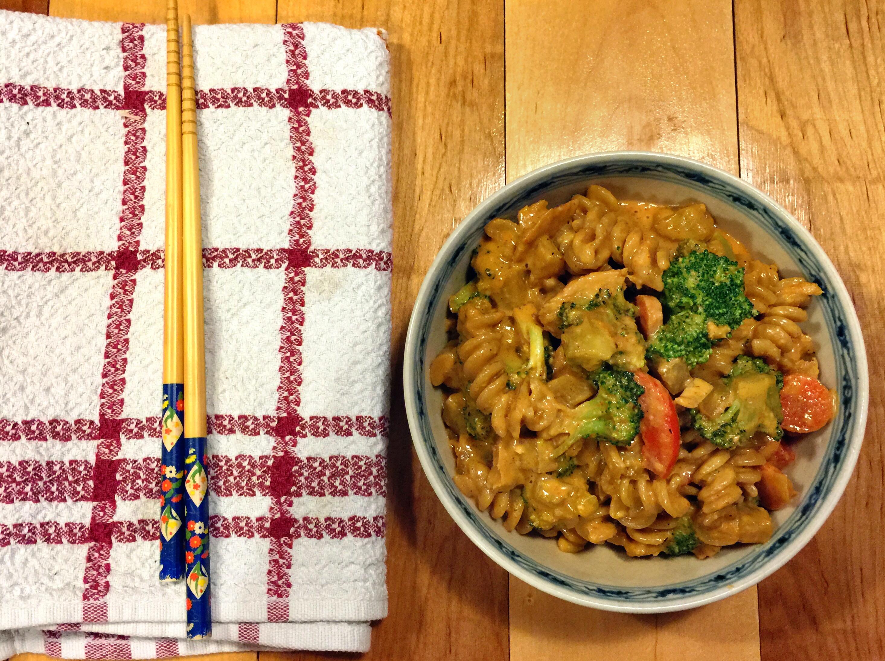 spicy peanut pasta served with chopsticks